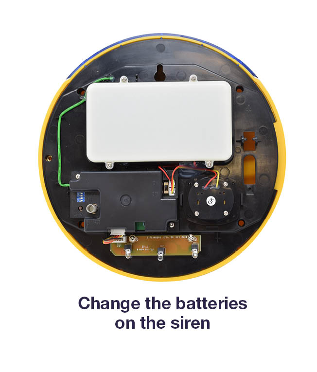 Image showing how to change the siren batteries on the HSA 6400.