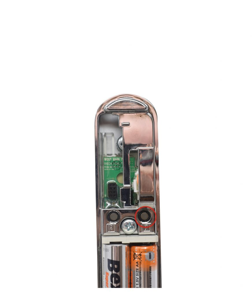 inside handle of the keyfree door lock with the I button highlighted in red