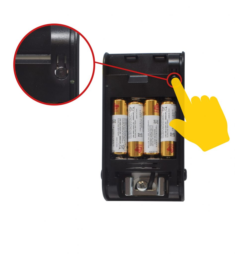 keyless connected smart door lock battery pack with hand pressing R button and all batteries in the pack