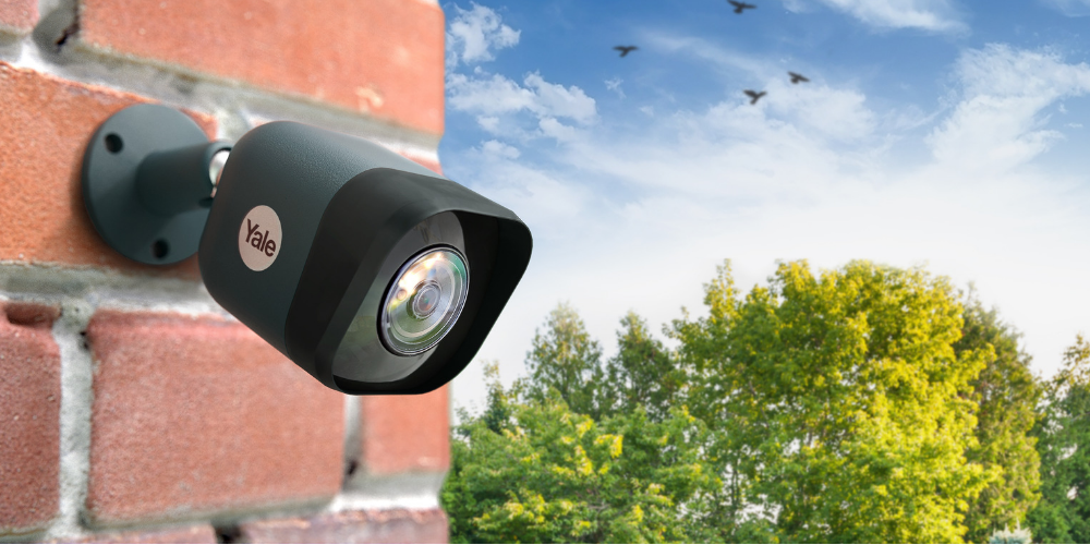 Image of CCTV camera outside of home. Concept of home security Jargon.